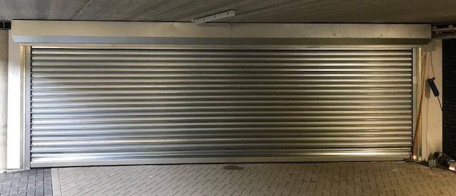 Enkelwandige stalen roldeur - Alpha deuren Zuid-West