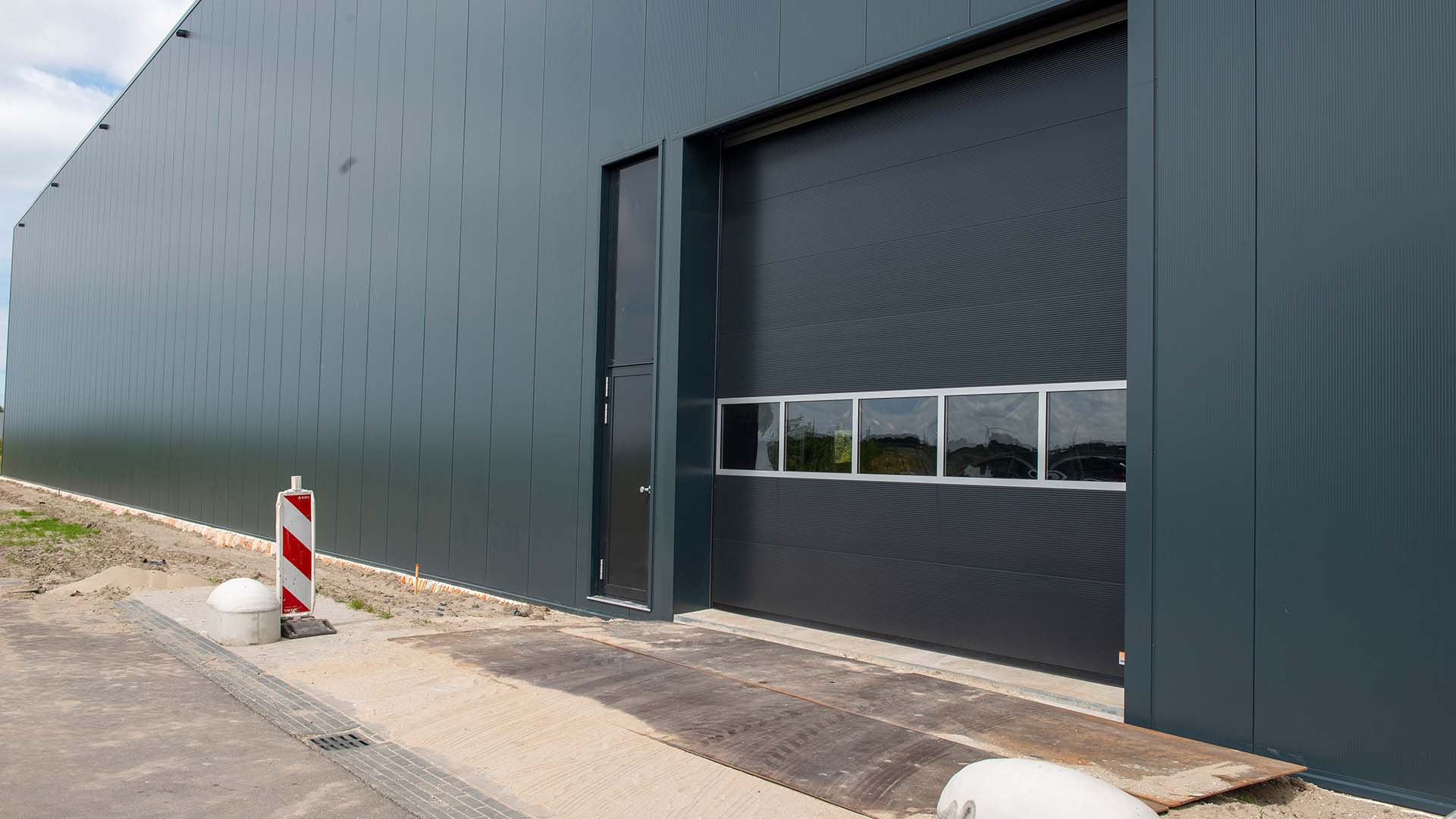 Sectionaaldeuren project - Alpha deuren Zuid-West